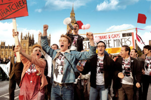(Front row, left to right) Faye Marsay as Steph, George Mackay as Joe, Joseph Gilgun as Mike, Paddy Considine as Dai and (second row, with megaphone) Ben Schnetzer as Mark in PRIDE to be released by CBS Films. Photo credit: Nicola Dove